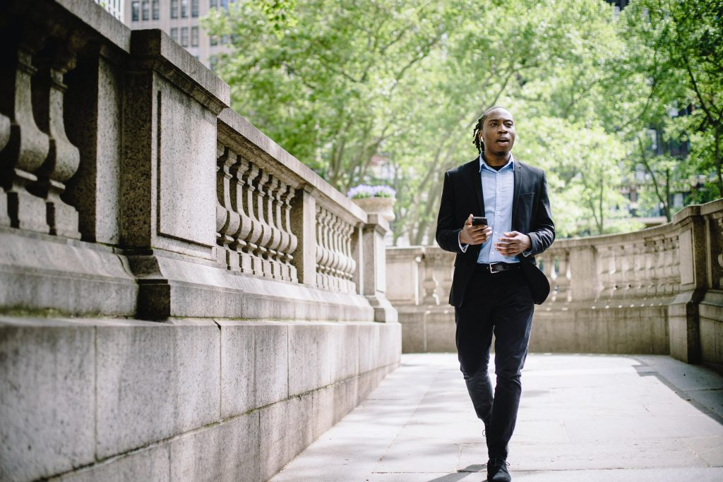 Man in a suit on a work call outdoors
