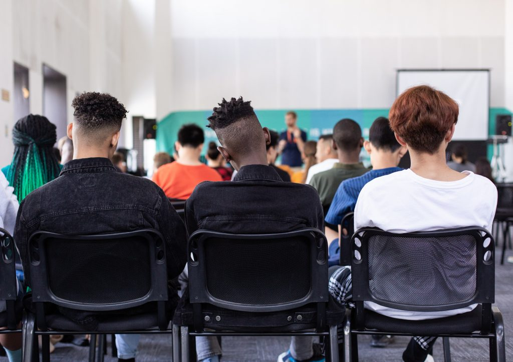 Backs of students in a classroom