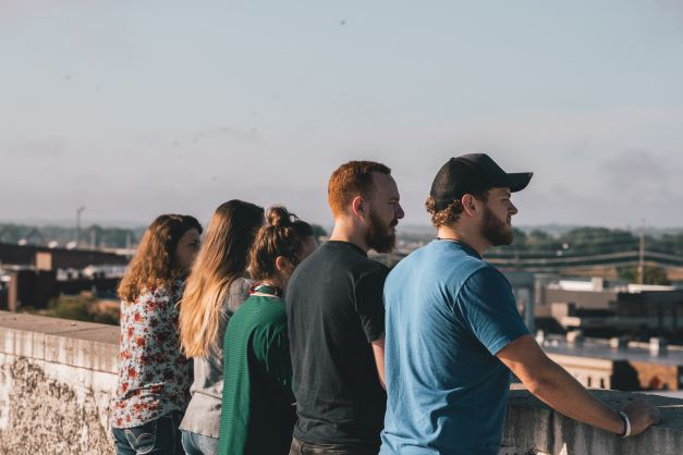Young people looking at the horizon
